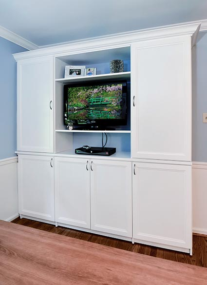 Media center and entainment unit with white cabinets