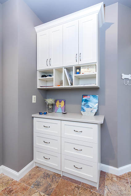 Mudroom with white cabinetry