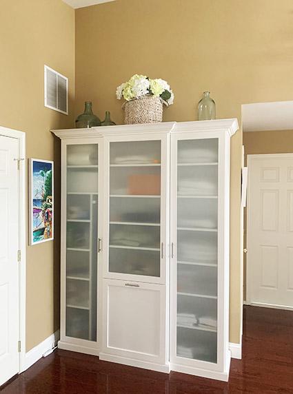 Custom built linen closet oganizing household items