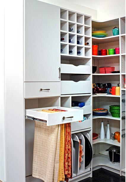 Table cloths neatly organized and folded in sliding drawer