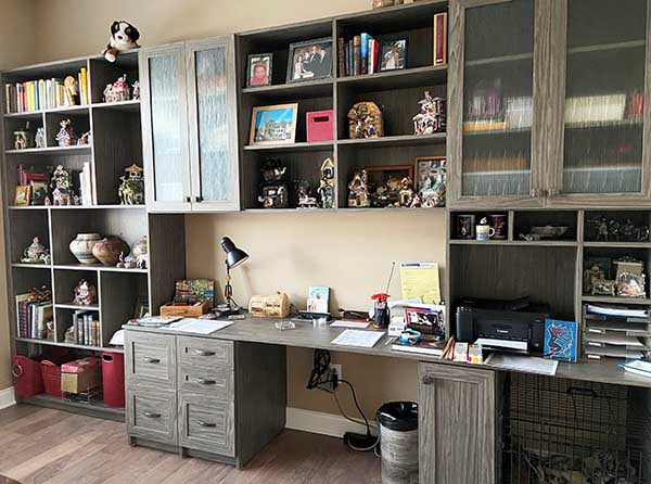 Home office with wood desk and cabinets