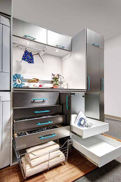 Laundry room with drawer sliders open