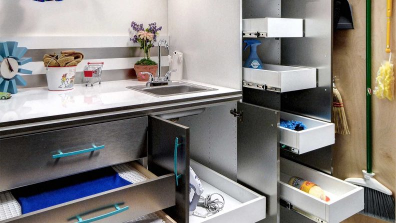 Organized laundry room with custom cabinets and shelving