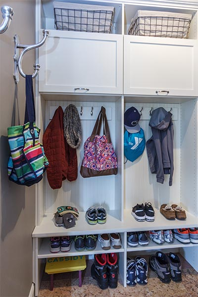 Mudroom neatly organized with cubbies and hooks