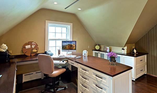 Custom home office with wrap around desk and matching cabinets