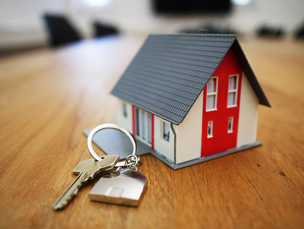 New home with key neatly organized on table