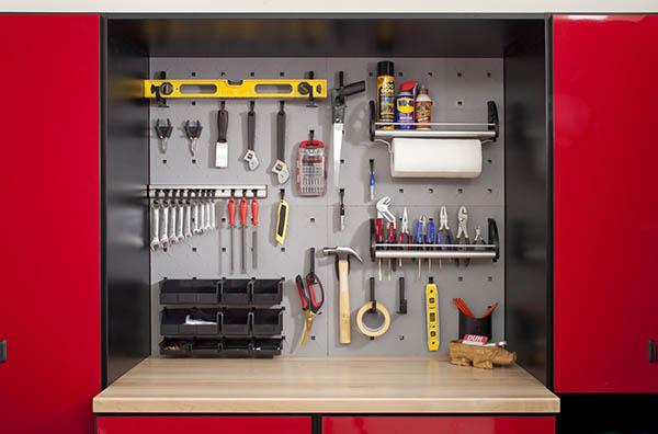 Tools organized with wall system above a butcher block workspace
