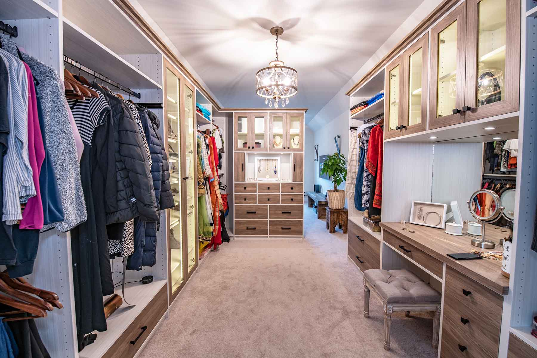 Woman walk in closet and sitting room by The Closet Works