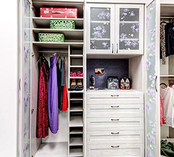 Wardrobe closet neatly organized with plenty of storage