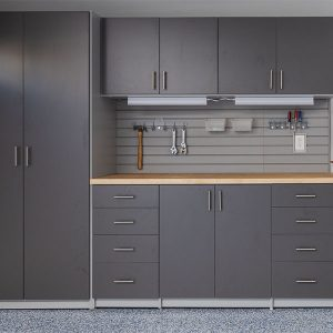 Butcher block worksurface surrounded by grey cabinets