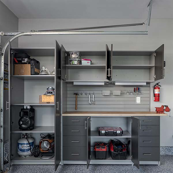 Organized garage cabinets with workbench area