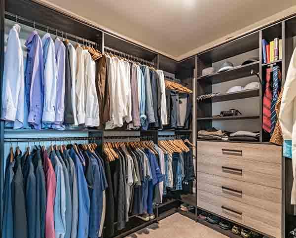 Men's walk-in closet neatly organized