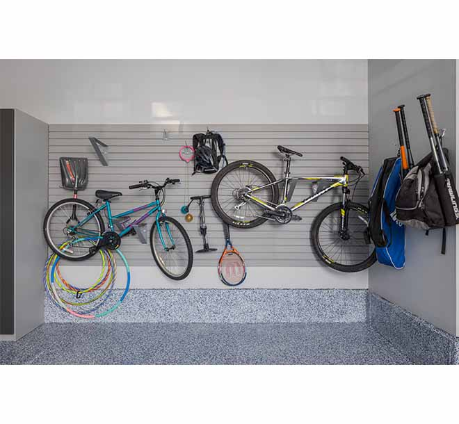 Wall unit maximizing space by storing bikes on brackets and hooks