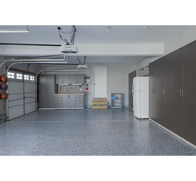 Garage unit with custom cabinets and slatwall system