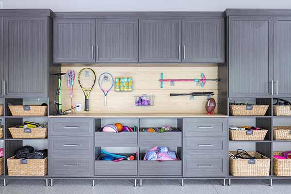 Grey garage organization system with cabinets