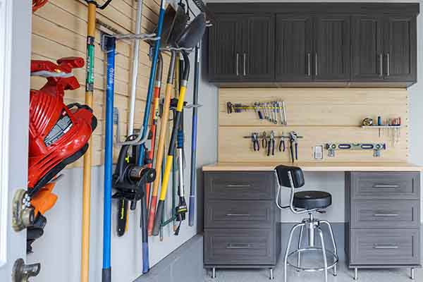 Organized garage space with slatwall system and butcher block workspace