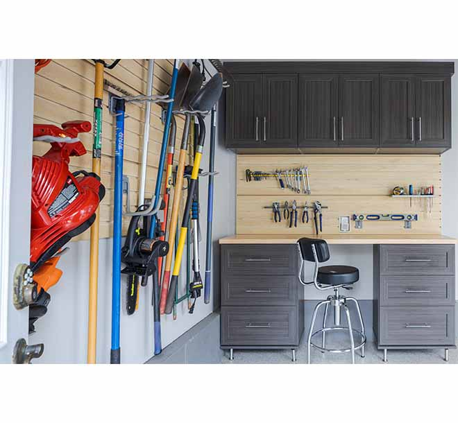Wall unit with tools neatly organized and hanging on hooks