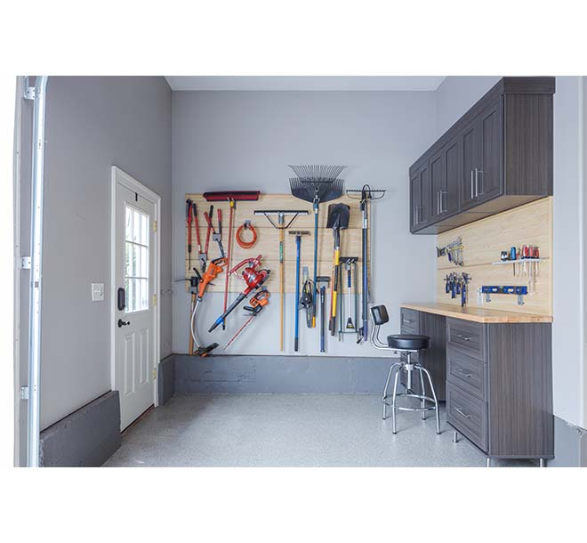 Garage space with butcher block and wall unit neatly organzing tools