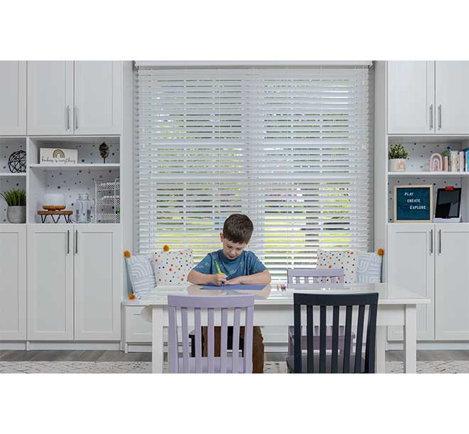 Child working on hobby with table and matching wall unit