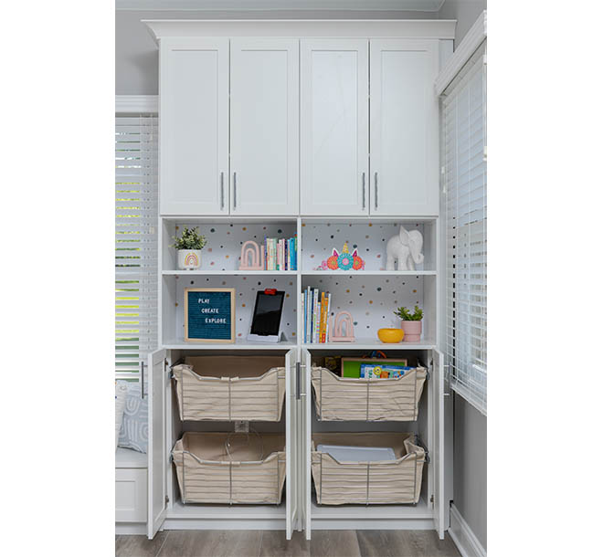 Wall unit with open shelving displaying collectible and closed shelving above