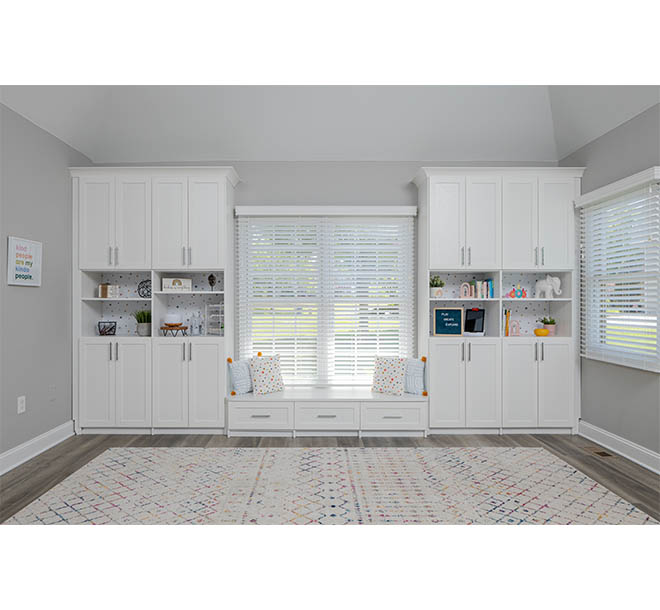 Build in wall unit with cabinets and shelves closed in play area