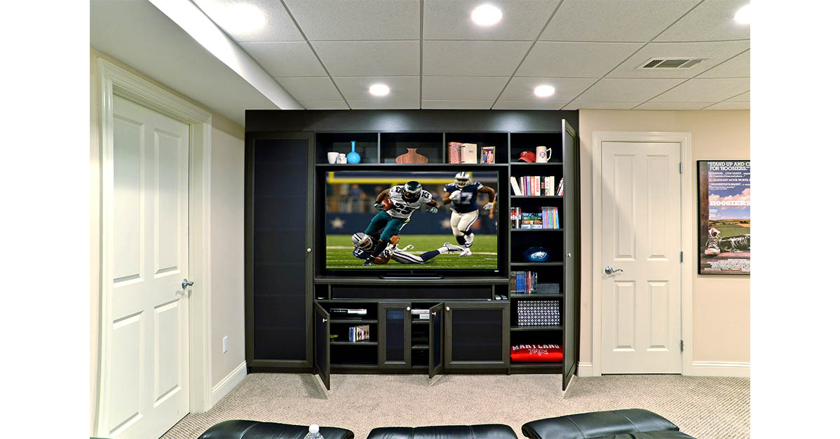 media center organization idea with beautiful custom wood cabinets and glass door inserts