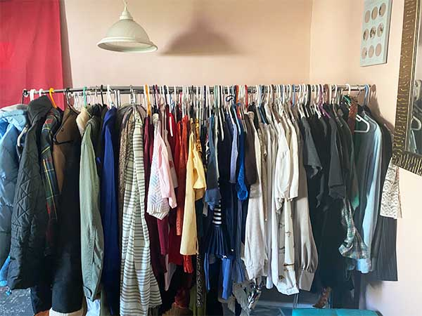 Clothes neatly hung on rack