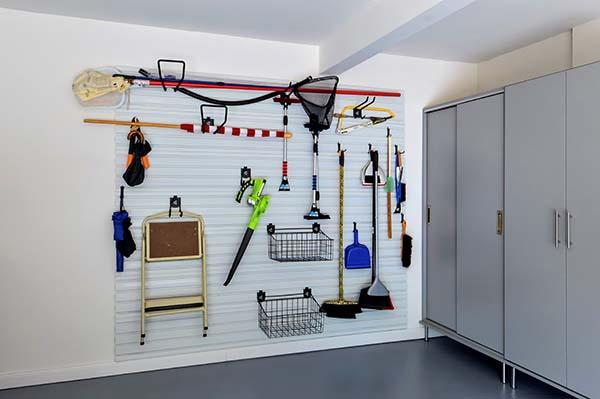 Outdoor gear neatly organized on garage wall system