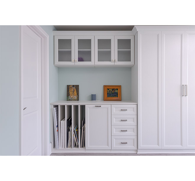 Wall bed closed with vertcial storage for art canvases