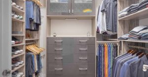 Mens custom closet design with ties and belts organized