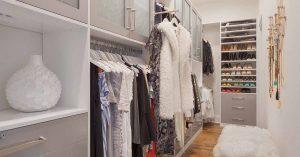 Long narrow custom closet with custom cabinets and shelves