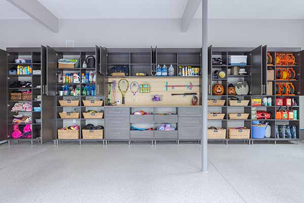 Garage organized with custom cabinets and shelves