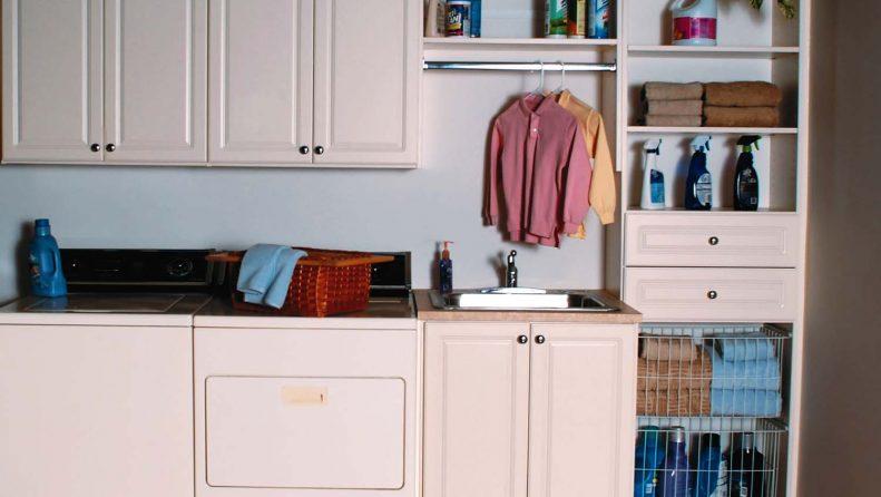 Laundry room design idea with custom cabinets