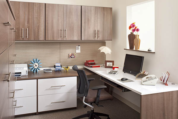 Neatly organized home office with custom shleves an desk
