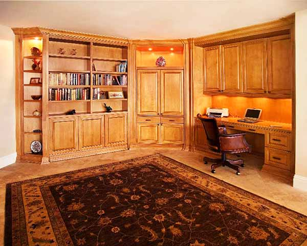Custom home office with Murphy bed finished in beautiful wood