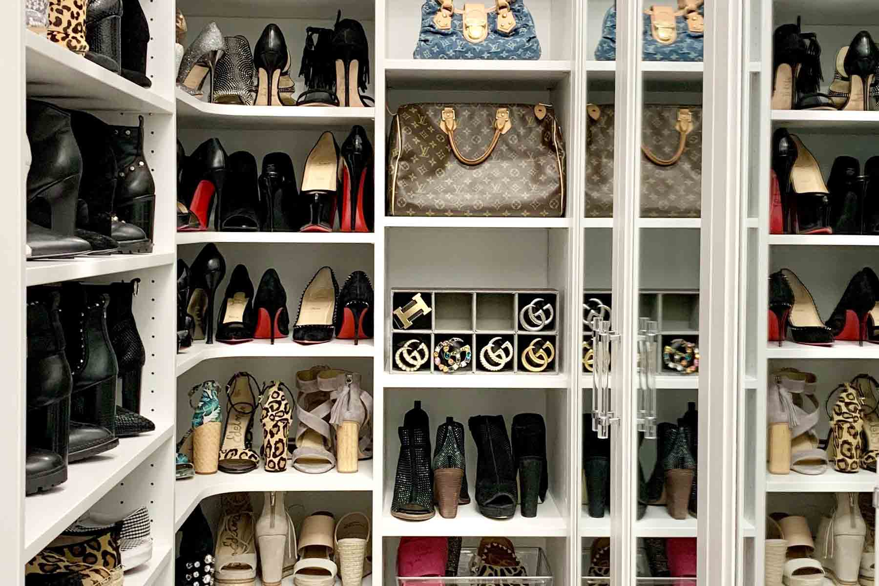 Walk-in closet with custom cabinets and shleving for shoe collection