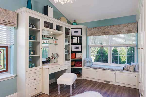 Walk-in closet and sitting room with built-in vanity