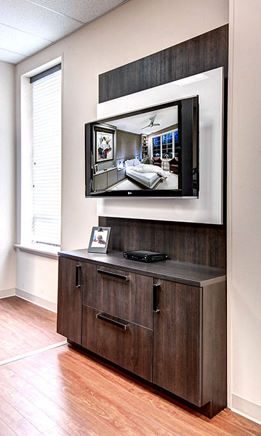 Home office media center with workspace and flat screen TV
