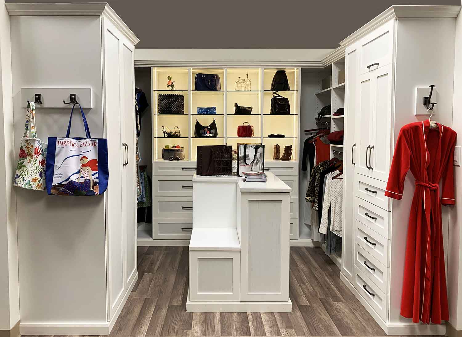 White walk in wardrobe with center island and seat