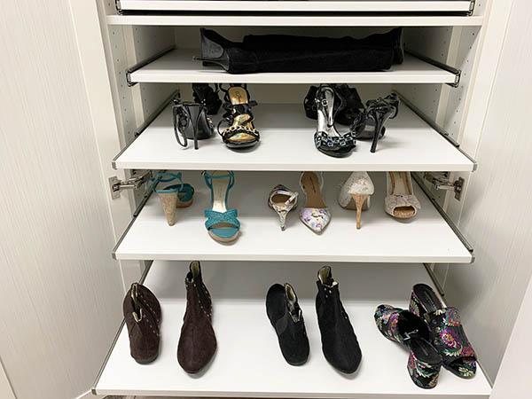 Sliding shoe shelves in custom closet cabinet
