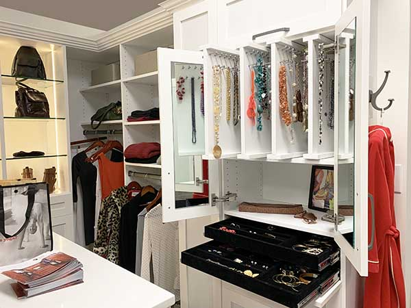 Pull-out necklace rack with jewelry drawers underneath