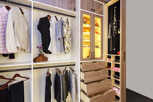 Closet with vertical sliding doors and double hanging