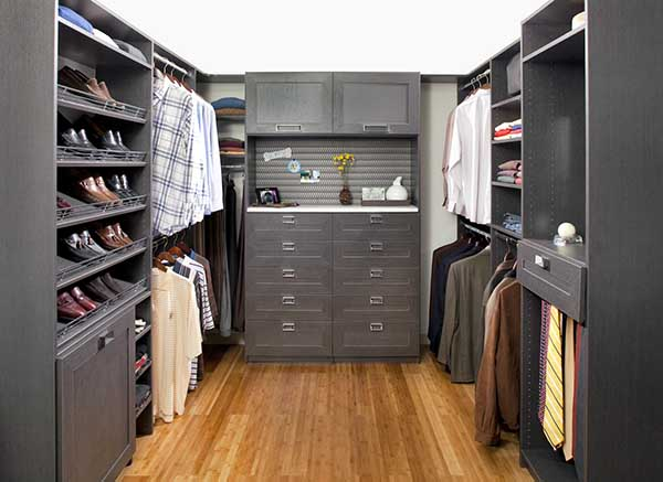 Closet with hanging sections and accessory storage like tie racks