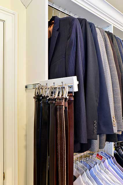 Slide-out belt rack in closet