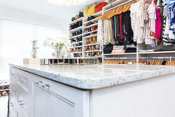 River white granite countertop in closet