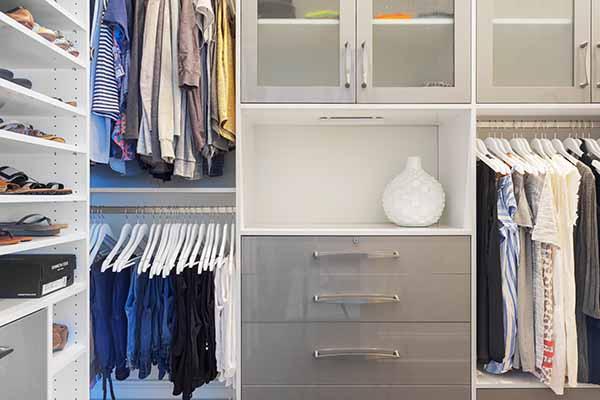 Walk in wardrobe with granite countertop
