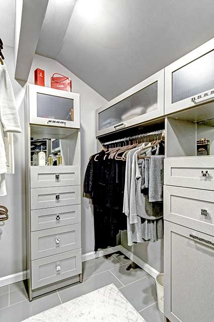 Closet cabinets designed around low corner ceiling