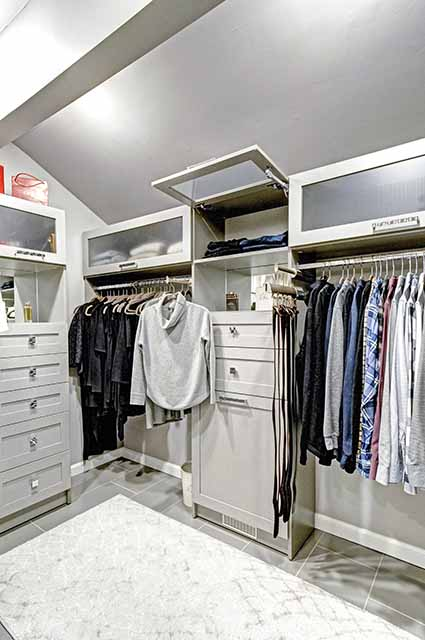 Custom closet cabinets with flip up doors above for additional stroage