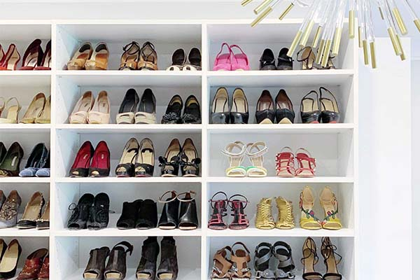 Shoes neatly displayed and organized on custom closet shelves