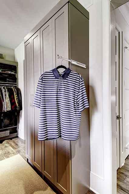 Slide out valet bar on closet cabinet